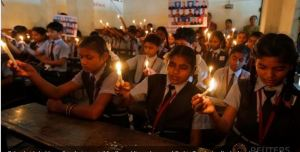 School girls hold candles during a vigil for the soldiers who were killed in Sunday's attack at an Indian army base in Kashmir's Uri, in Ahmedabad, India, September 20, 2016. REUTERS/Amit Dave
