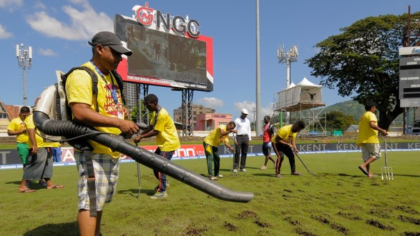 FLASHBACK: Ground staff use a blower to dry the field under the supervision of umpire Gregory Brathwaite (4L) during day 3 of the 4th and final Test between West Indies and India at Queen's Park Oval in Port of Spain, Trinidad on August 20, 2016. / AFP PHOTO / Randy BROOKS
