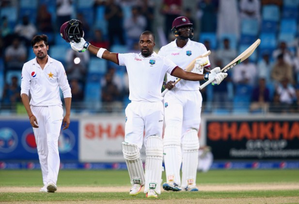 DUBAI, UNITED ARAB EMIRATES - OCTOBER 17:  Darren Bravo of West Indies celebrates reaching his century during Day Five of the First Test between Pakistan and West Indies at Dubai International Cricket Ground on October 17, 2016 in Dubai, United Arab Emirates.  (Photo by Francois Nel/Getty Images)