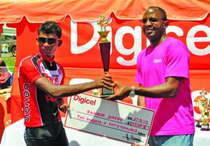 Flashback! Two-time defending champion Raynauth Jeffrey receiving his prize from then Digicel, CEO Gregory Dean