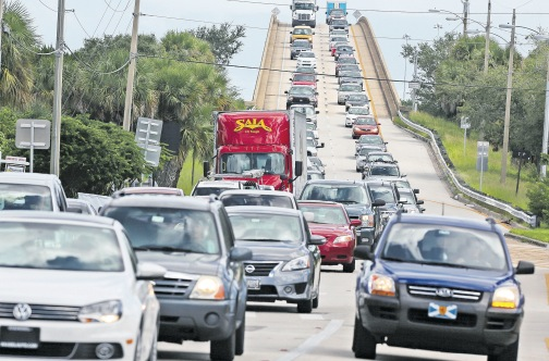 People in vehicles take an evacuation route over 520 bridge heading west from Merritt Island, Florida, yesterday, as Hurricane Matthew approaches The Sunshine State. (Photo: AP)