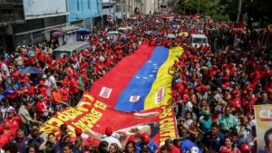Supporters of Nicolas Maduro took to the streets of Caracas on Tuesday (EPA)