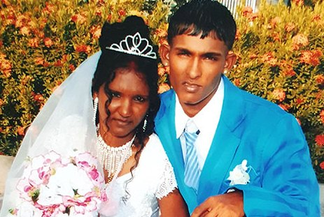 """Roland """"Vishal"""" Jodmie and his wife Tarmattie Kumar and on their wedding day"""