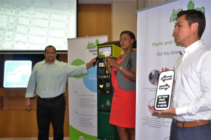 Smart City Solutions employees demonstrating how the meters will be used