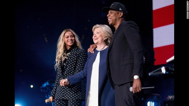 Democratic presidential nominee Hillary Clinton joins music power couple Beyoncé and Jay Z on stage during a free concert on November 4 in Cleveland.