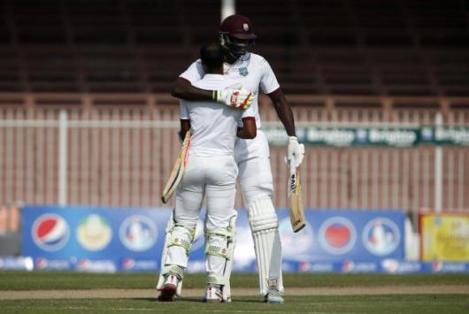 Jason Holder was in the middle when Kraigg Braithwaite reached his century (Photo: Getty Images)