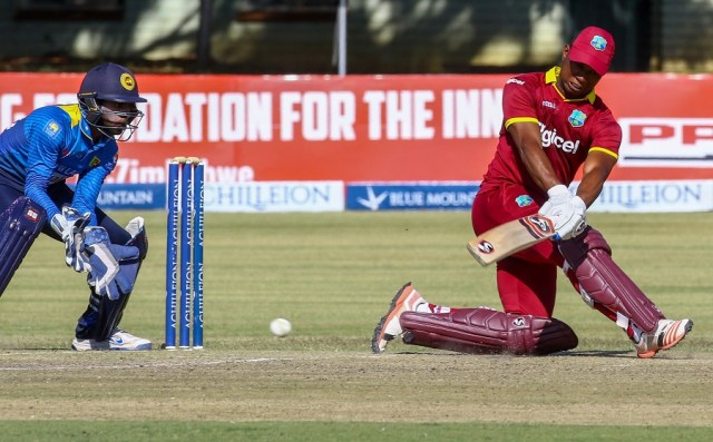 Evin Lewis battled cramps to raise his maiden ODI century, but West Indies' unsuccessful streak chasing 300+ scores continued © AFP