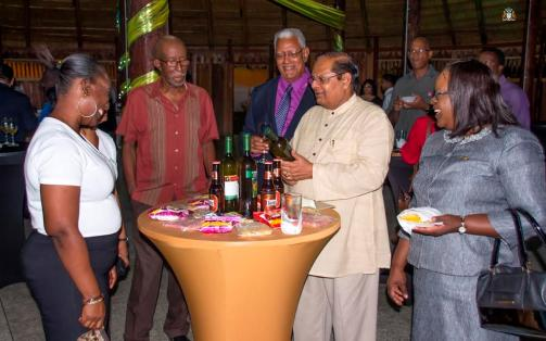 Prime Minister Moses Nagamootoo and Agriculture Minister Noel Holder with other guests at the event