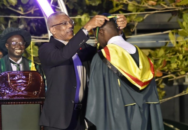 President David Granger presenting the President's Medal to the University of Guyana's 2016 Valedictorian, Kibwey Peterkin. This is the first time in the history of the University that a student from the School of Medicine in the Health Sciences Faculty has been able to capture the title.