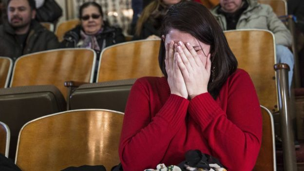 Anne Devlin, from Plano, Texas, cries in the gallery of the the state capitol after the electoral college vote in Austin, Texas(AP Image)