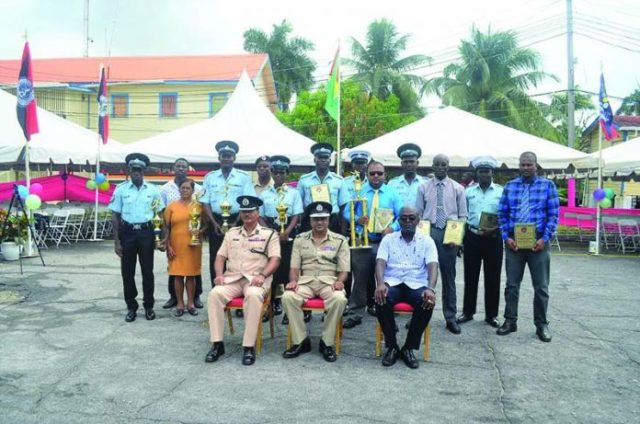 Police Commissioner Seelall Persaud and Assistant Commissioners David Ramnarine and Brian Joseph, along with some of the top performing ranks who were awarded, including Best Cop Prem Narine (blue shirt) and Runner-up Best Cop Herbert Henry (grey shirt)
