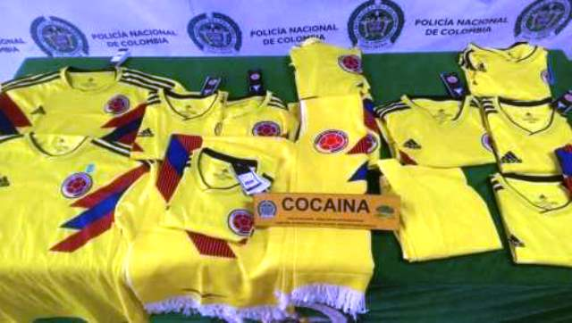 43cfb23e9 In this handout photo provided by the Colombian National Police, shows  replica World Cup soccer jerseys for Colombia's national soccer team soaked  with ...