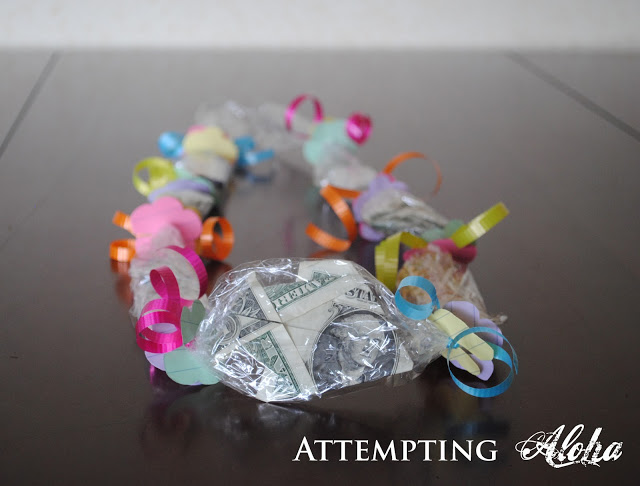 Attempting Aloha how to make candy lei with origami dollar fish