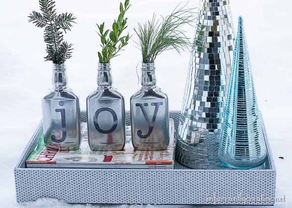 silver vases with greenery