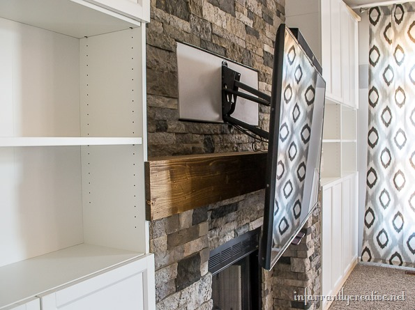 mantel mount with stone fireplace