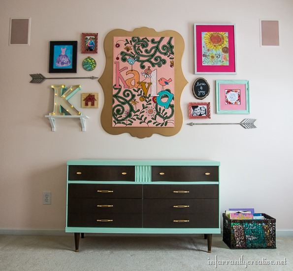 mint dresser with gallery wall