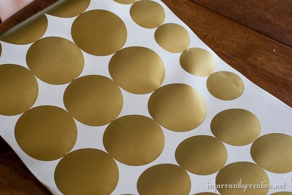 gold vinyl dots on a wall