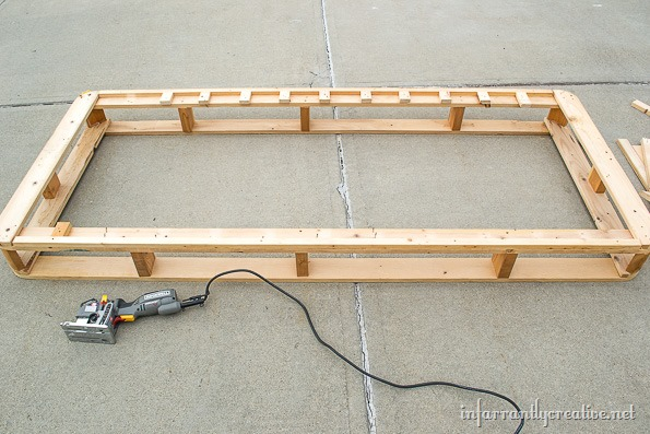 Cutting-a-wood-boxspring