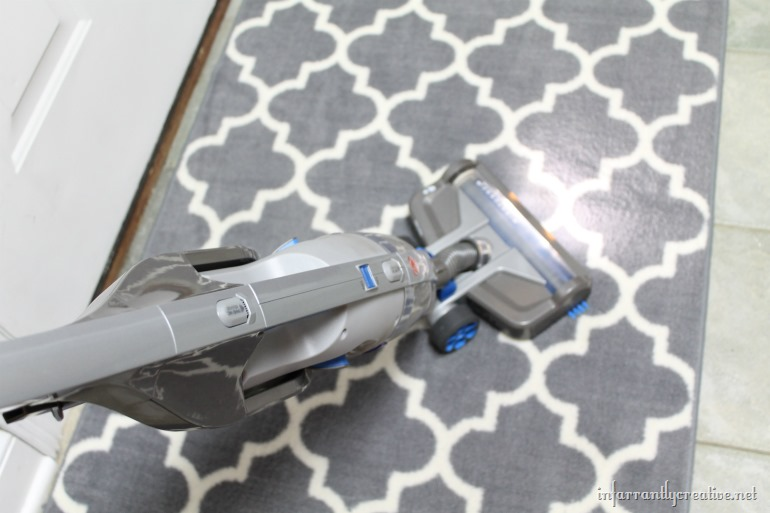 vacuuming-rug-with-hoover