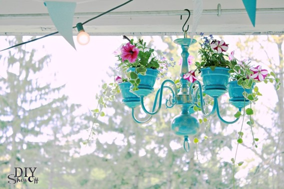 Add flower pots to a chandelier to turn into a hanging planter!