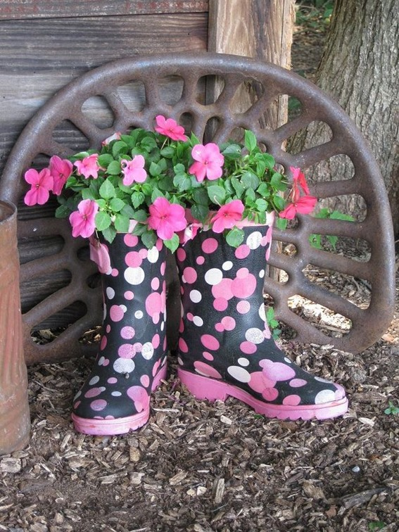 Repurpose a pair of old rainboots into planters for your porch!