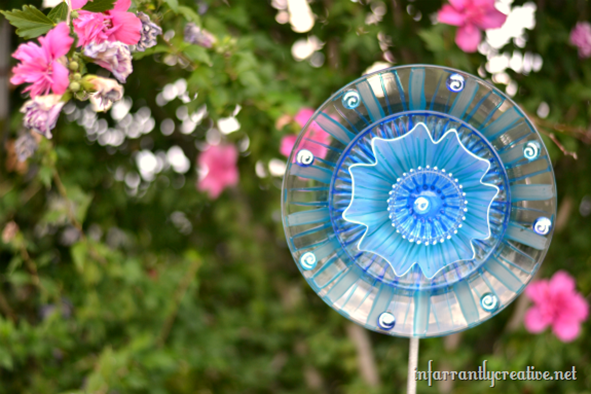Turn plates from the dollar store into pretty flowers for your garden!