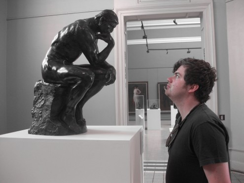 man looking at the thinker