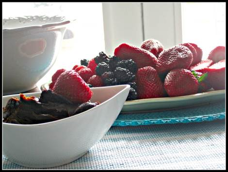 chocolate peanut fudge dip with berries