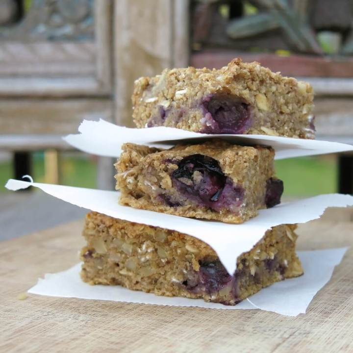 blueberry snack cakes stacked with parchment paper