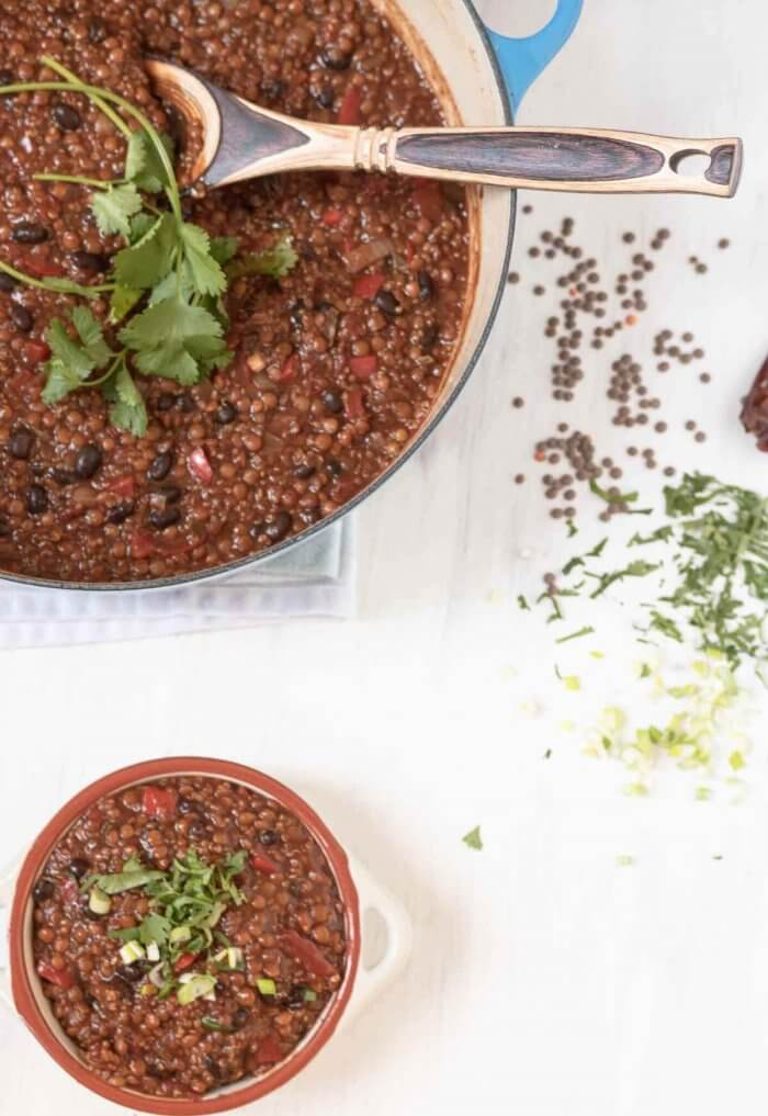 lentil and black bean chili with quinoa in large soup pot