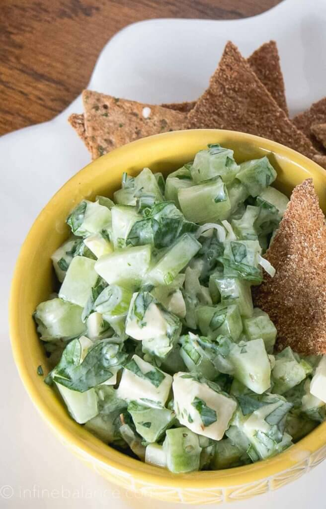 cucumber and feta salad in small yellow bowls