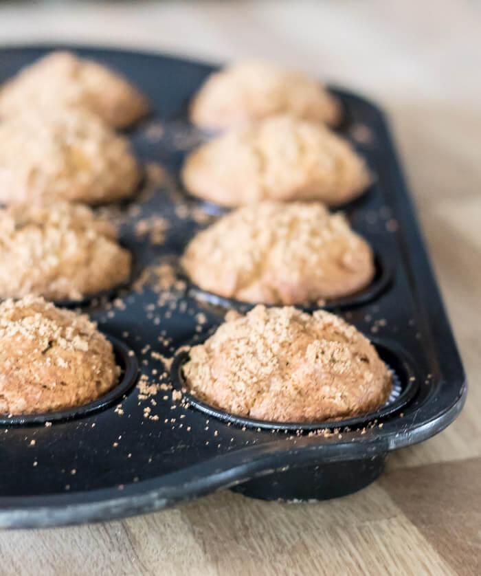 muffin tin full of pumpkin butter muffins with cinnamon sugar