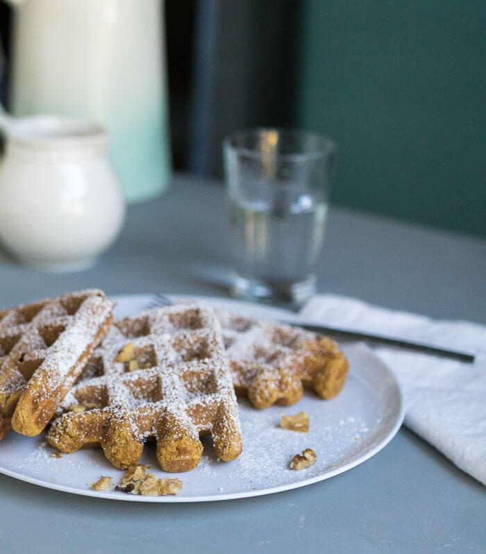 Pumpkin Pie Waffles on a plate with powdered sugar