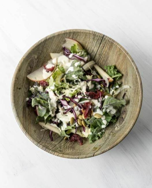 apple and kale salad tossed with sweet garlic dressing