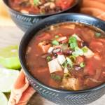turkey enchilada soup in a black bowl
