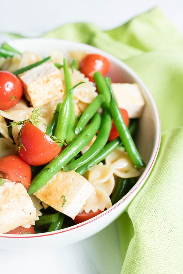 Close up of Summer Pasta Salad with Tofu, Cherry Tomatoes and Green Beans