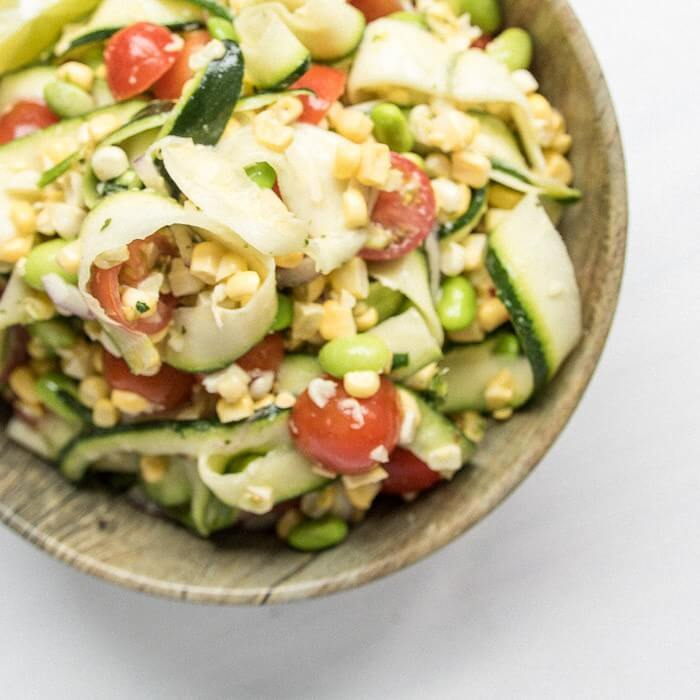 Sweet Corn and Zucchini Salad in a bowl close up