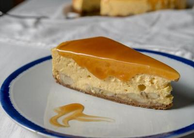 a slice of banana cheesecake on a plate with caramel sauce