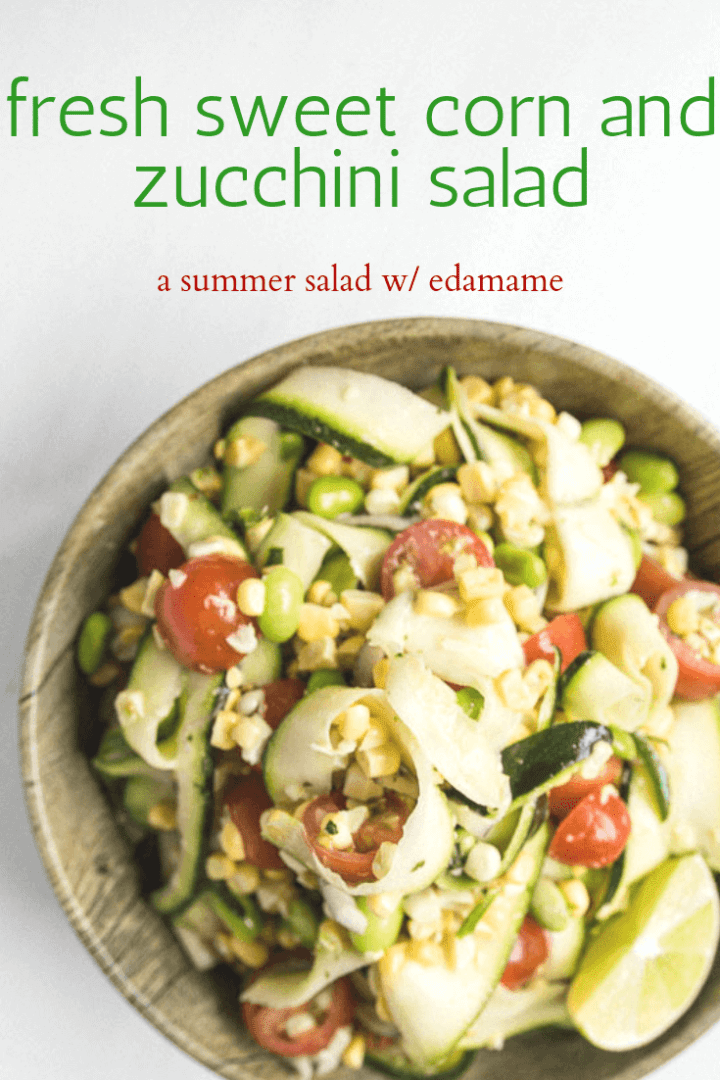 Sweet Corn and Zucchini Salad with honey lime dressing. Served with a slice of lime.