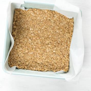 press oat and brown sugar mixture into bottom of pan to make oat bars