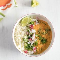 Red lentil curry in a bowl with rice