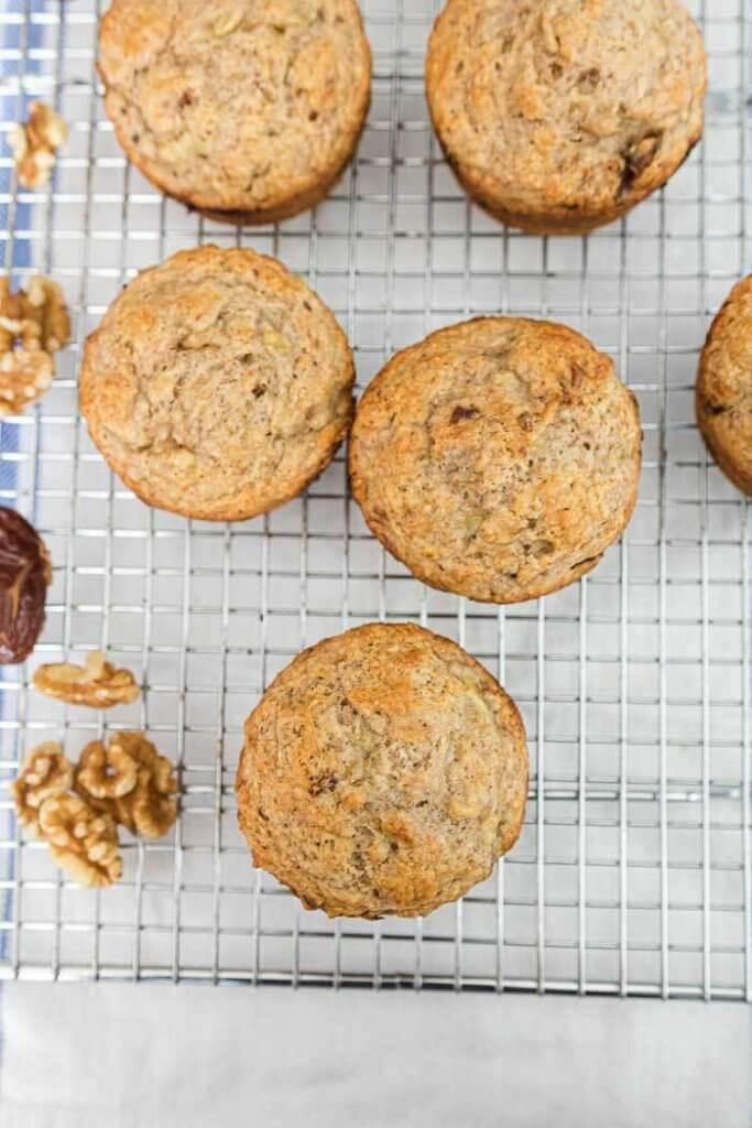 banana muffins with dates and walnuts on a baking rack