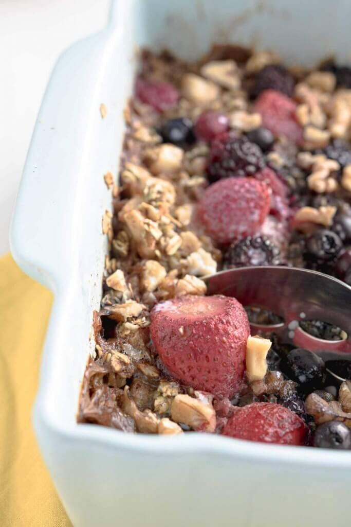 close up of berry baked oats in a serving dish