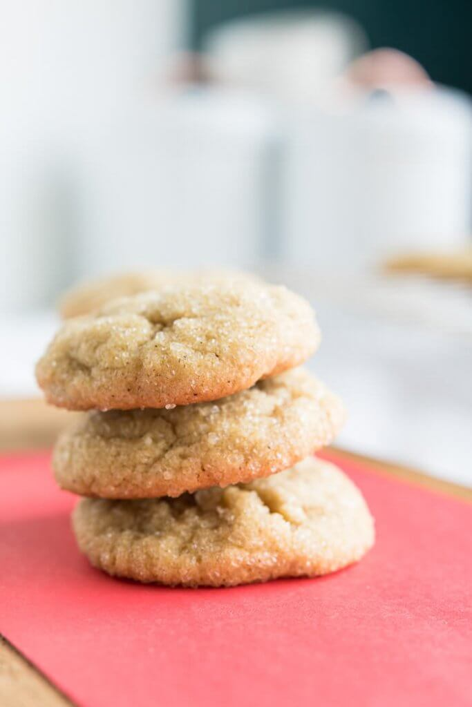 a stack of chewy almond flour brown sugar cookies on a red table top