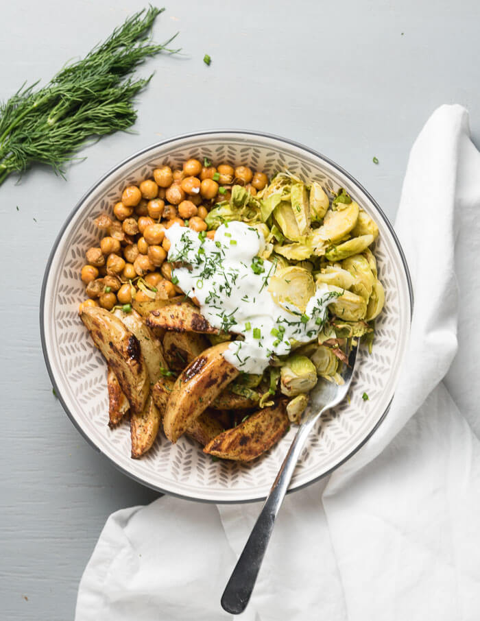 roasted chickpea potato bowls with dill sauce and roasted Brussel Sprouts