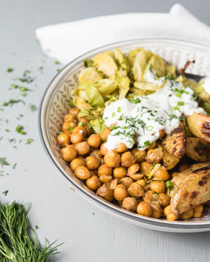 lemon and dill roasted chickpeas and potato bowls with vegan dill sauce and brussel sprouts
