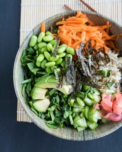 sushi salad with ingredients layered in a bowl