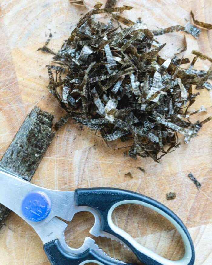 sheets of nori seaweed, rolled up and cut with scissors