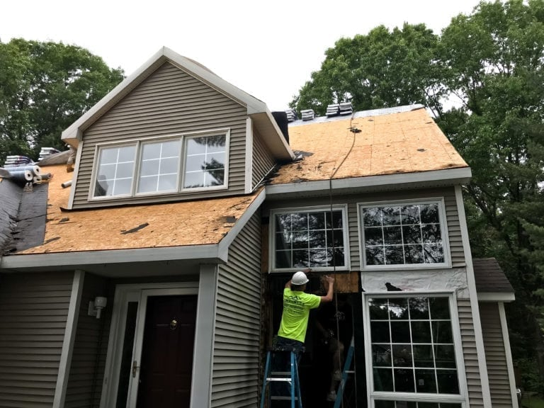 Roof repair in progress by infinite roofing