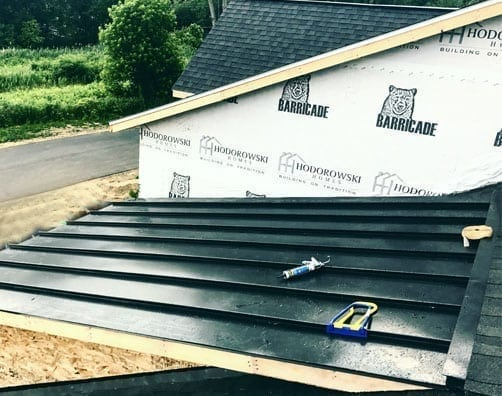 Infinite Roofing partial metal roof install on new construction